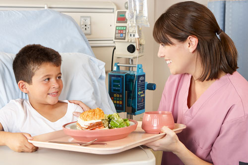 Serving a meal to a patient